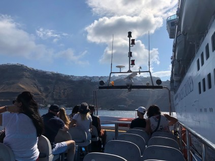 Tender service from ship to shore in Santorini