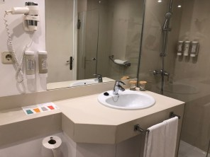 Compact bathroom with walk in shower, eco friendly soap, hair shampoo & conditioner, body lotion, hairdryer, shaving mirror and bidet.