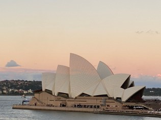 Sun setting down the sails of the Opera House