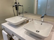 His & her sinks, with shower cubicle and toilet