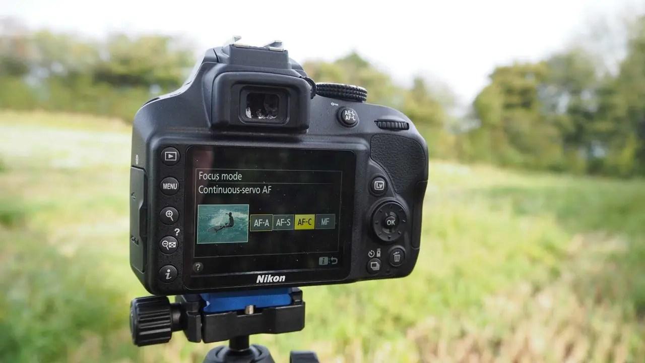 How to set the Nikon D3400 focus mode select AF mode option