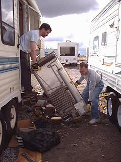 Brent and Kent haul the old fridge out of the trailer