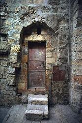 Old door in ancient building, Rhodos, Greece, photograph by Brent VanFossen