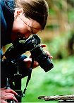 Photographer Ann Smart gets upclose and personal with an inch worm.  Photo by Lorelle VanFossen