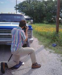 Brent photographs flowers in Texas, photo by Lorelle VanFossen
