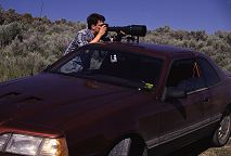 Brent uses the roof of our old sports car with the groofwin as a tripod. Photo by Lorelle VanFossen