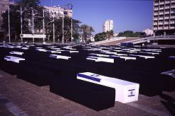 Fake coffins fill Rabin Square in Tel Aviv recognizing all who have died in the Intifada and since the Olso Accords. Photo by Lorelle VanFossen