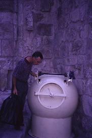 Kent VanFossen inspects the bomb detonator near the entrance to the Holy Sepulcher, Jerusalem. Photo by Lorelle VanFosssen