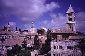 Churches and mosques from the rooftop of Jerusalem, photo by Lorelle VanFossen
