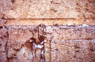 Notes stuck in the Western Wall or Wailing Wall, photo by Lorelle VanFossen