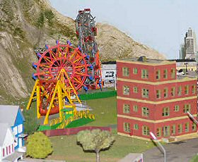 A carnival comes to this minature town with a Ferris Wheel and model trains