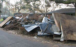 Debris from roofs, piers, and damaged trees line the road everywhere you drive in Mobile, photograph by Lorelle VanFossen
