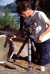 Brent holds a reflector while working with a subject, photograph by Lorelle VanFossen