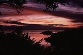 Purple sunset over Deception Pass, Washington, photograph by Lorelle VanFossen