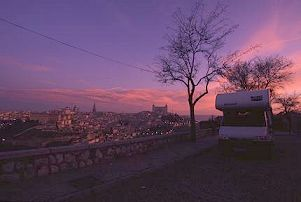 The motorhome sits in the sunrise overlooking Toledo, Spain, photo by Brent VanFossen