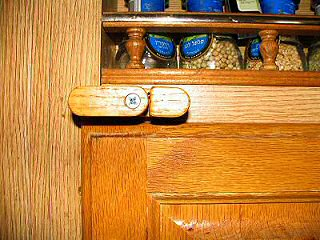view of one of the lower cabinet latches Brent custom made
