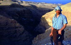 Brent dresses Arab-like as he stands on an overlook of a valley in which lies an ancient monastary. Photo by Lorelle VanFossen