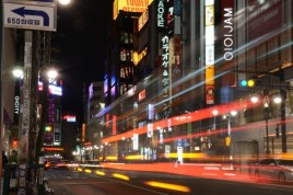 Blur of cars on city street - Japan - photography by Brent VanFossen.
