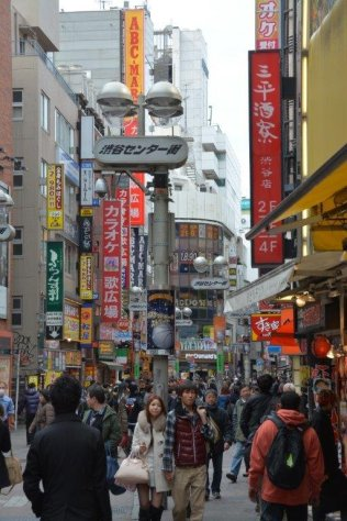 City street full of people and store signs - Japan - photography by Brent VanFossen
