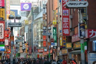 City street full of store signs and people - Tokyo - Japan - photography by Brent VanFossen