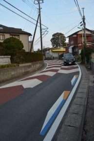 Road with painted navigation directons - Japan - photography by Brent VanFossen.