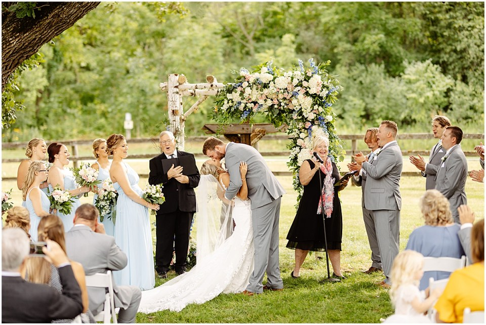 Ceremony kiss outside of Mayowood Stone Barn