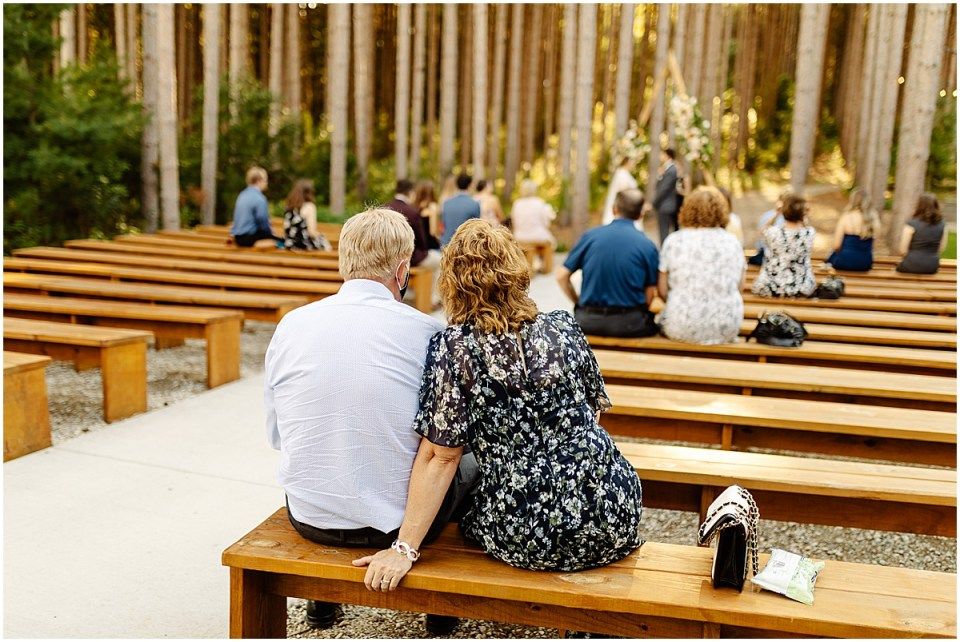 Ceremony outdoors in pines at Pinewood Weddings & Events
