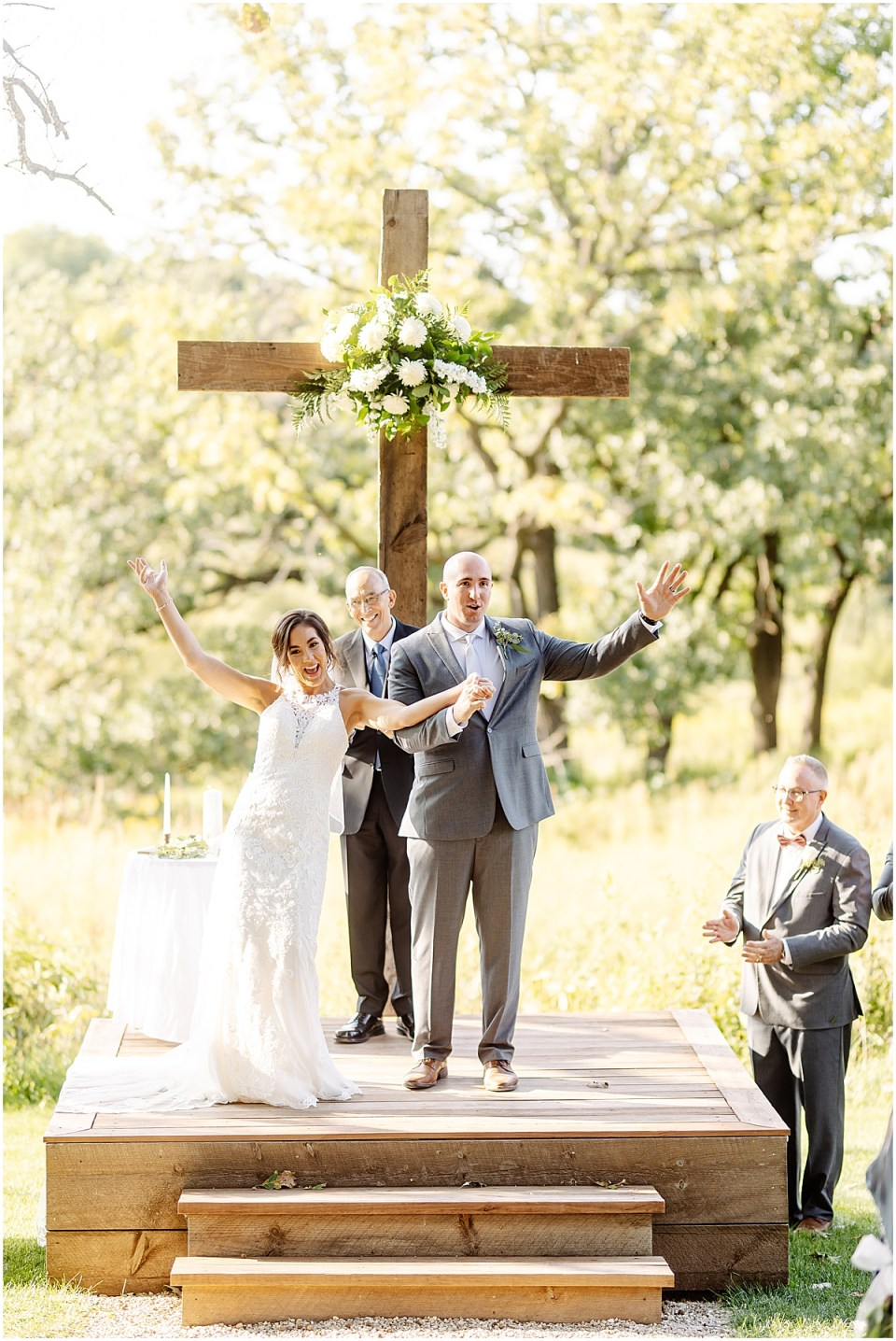 floral cross at wedding by weddings your way floral and events