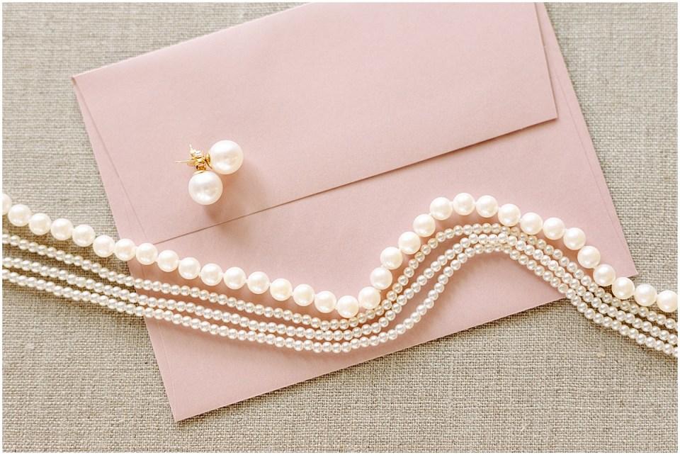 wedding jewelry pearls flat lay