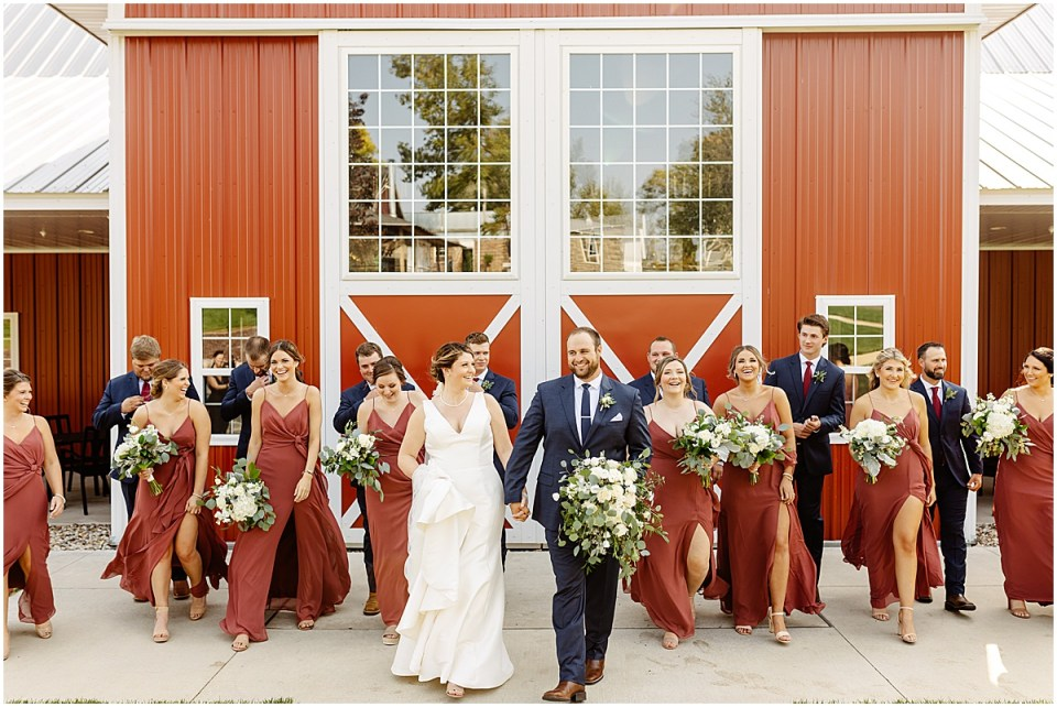 full bridal party walking forward picture at red barn farm