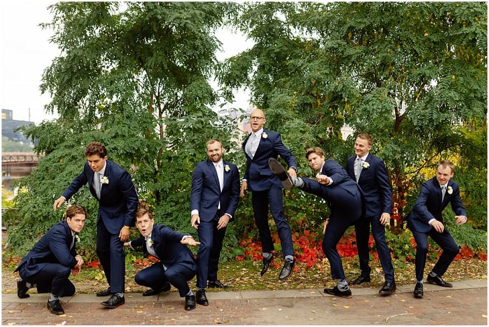 Jumping groomsmen in The Black Tux