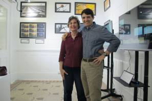 My mother and I posing in front of my MFA Gallery show