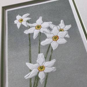 handmade linocut print of white narcissus poeticus flowers against graded grey background