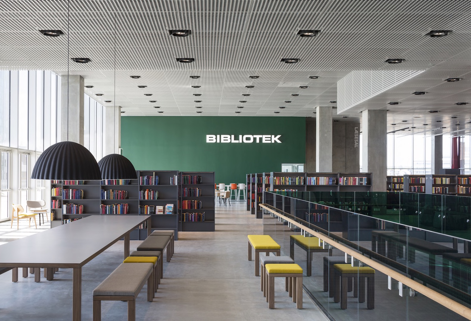 An architectural shot of the modern and colorful interior of the Dokk1 library.