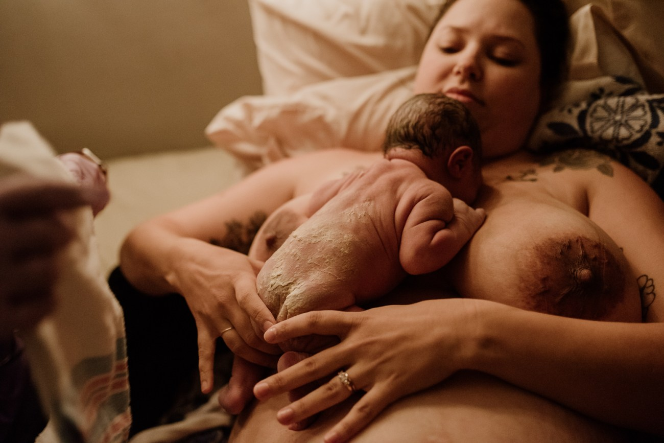 virginia woman just gave birth and is preparing to breastfeed.