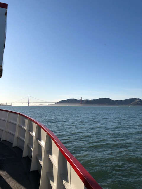 A distant view of the Golden Gate Bridge from the boat on the bay excursion.