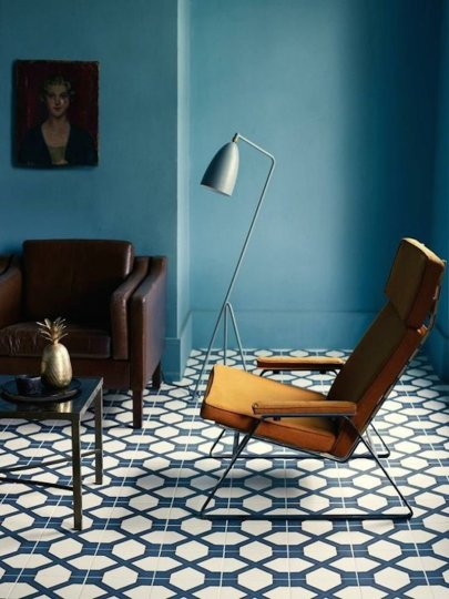 10 Best Bold Tile Floors   Camille Styles blue living room with bold tile and mid century modern lounge chair