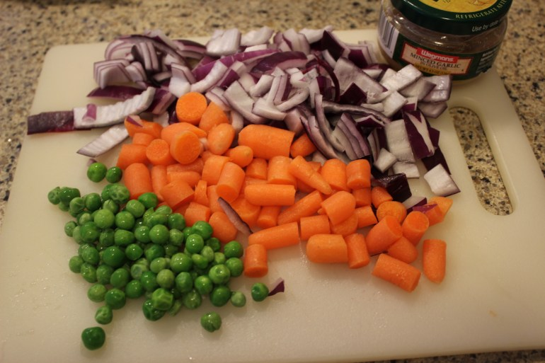 Onion, garlic, carrots, and peas for easy fried rice