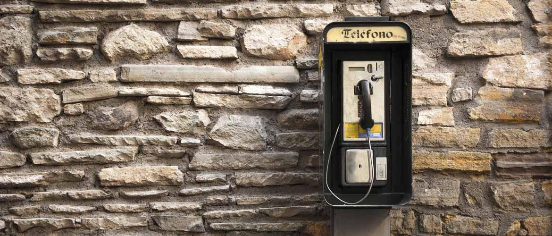 Old stylish Spanish Telephone on brick wall