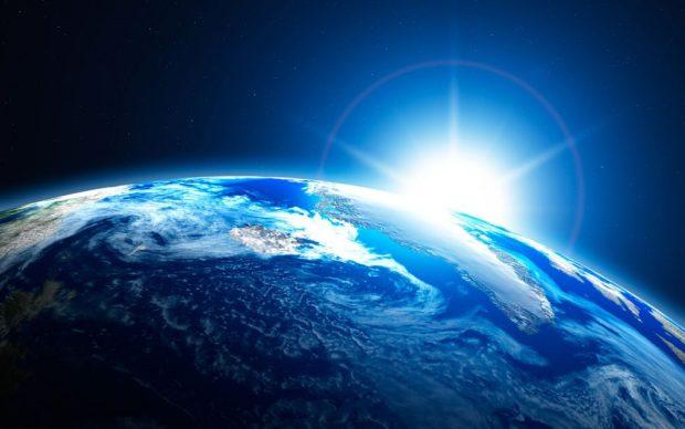terra-dallo-spazio-con-alba-del-sole