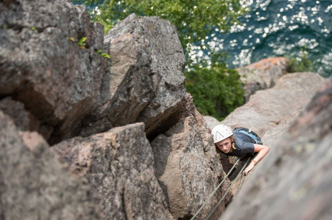 Aerial view of a girl rock climbing