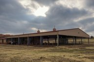 Exterior view of Whispering Prairie Covered Barn and Riding Ring