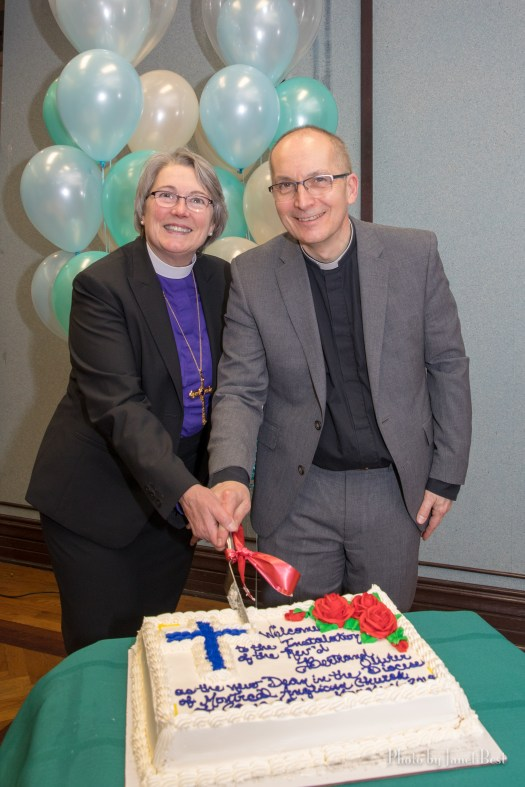 Dean Bertrand Olivier and Bishop Mary Irwin-Gibson cut the cake at reception following Dean's installation as Rector of Christ Church Cathedral and Dean of Montreal on March 11, 2018