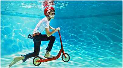 getty_rf_photo_of_boy_riding_scooter_underwater