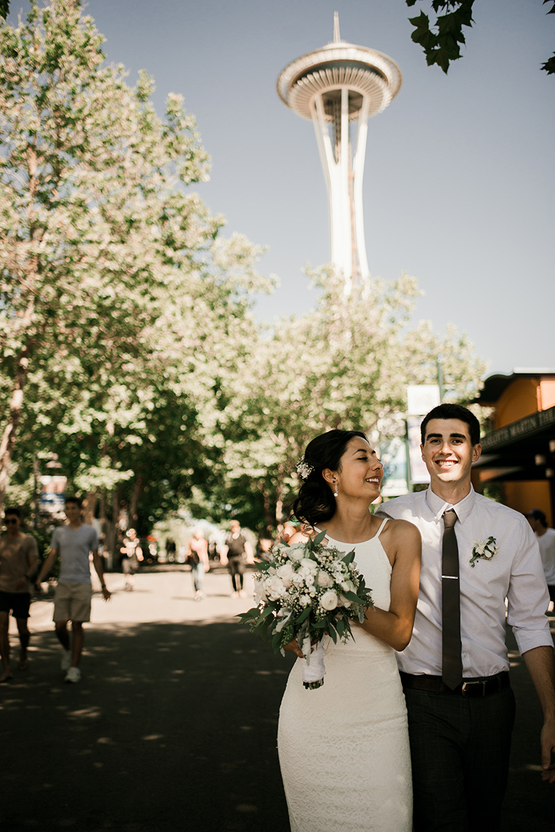 Couple walking for Wedding Photos by the Space Needle