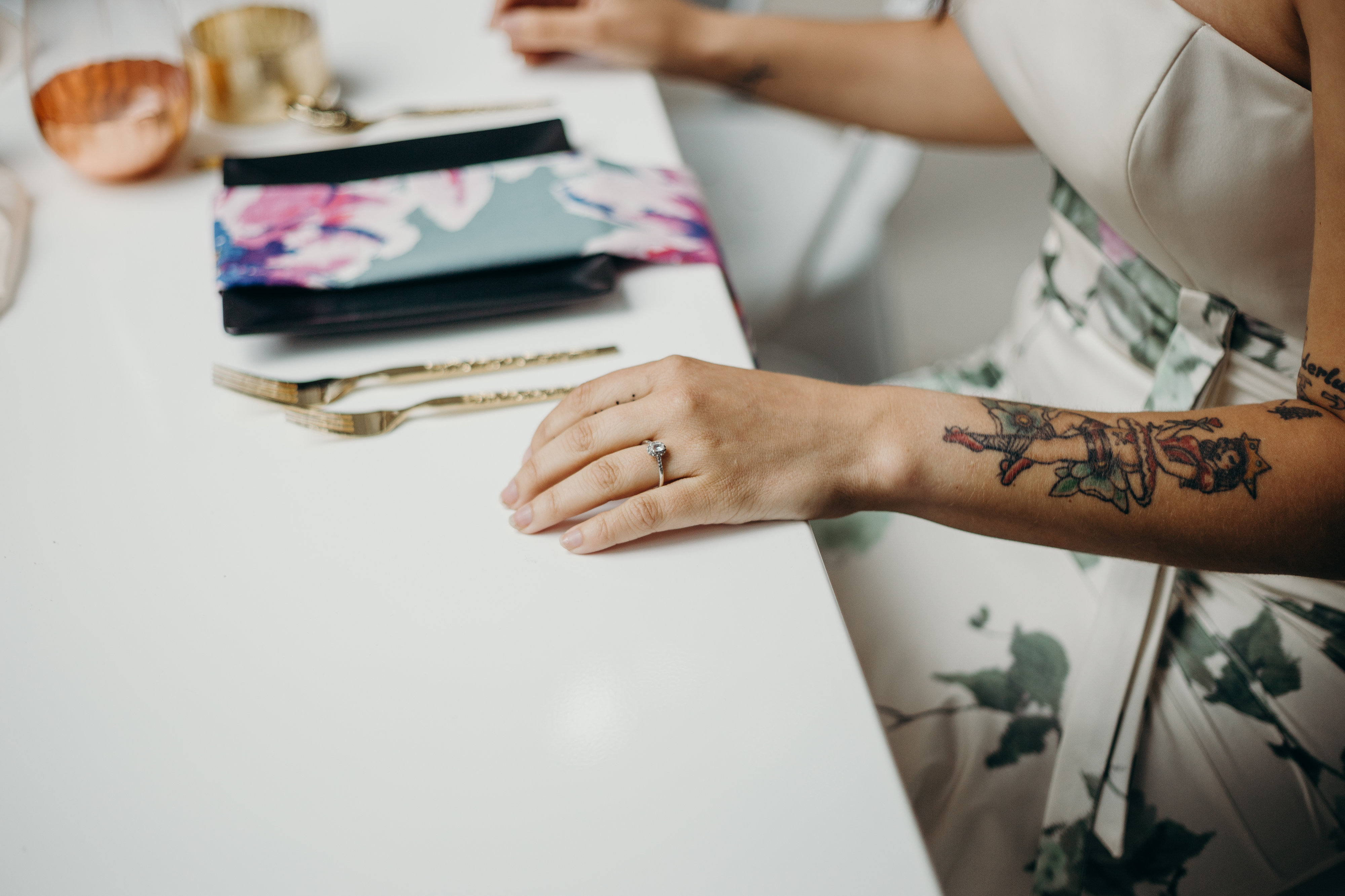 Tattooed Bride sitting at reception table