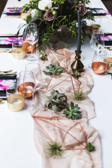 Tablescape with succulents and copper accents