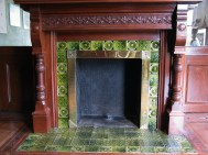 Morning Room fireplace during 2006 restoration - check out those snazzy tiles! Side note: this is the only wooden mantle in the entire house, with all the rest being marble or feaux marble.