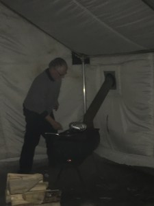 Terry making jiffy pop in the warming tent