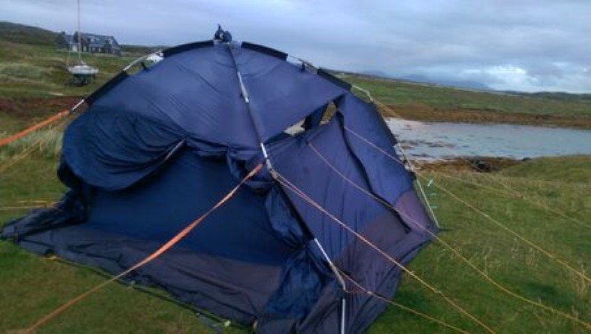 Tethering the drive away awning to terra firma in the face of the gale blowing in from the Atlantic to Clifden - a blue task. Also blue, the task of throwing the awning away when the wind ripped a hole through it making it unusable.